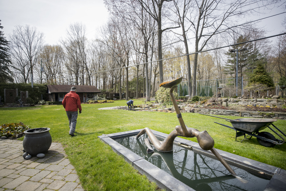 In the English-influenced garden, the bronze sculpture The Bather draws attention.  During the summer, the dome held at arm's length will be beautifully flowered.
