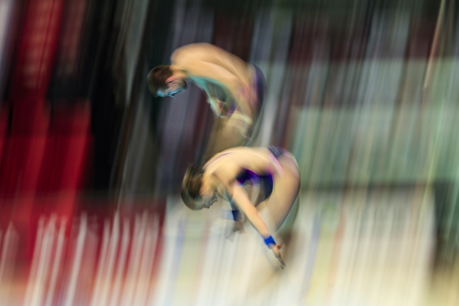 Le duo russe au plongeon de 10mètres mixte, Viktor Minibaev et Ekaterina Beliaeva, lors des Séries mondiales de plongeon au Centre sportif du Parc Olympique.