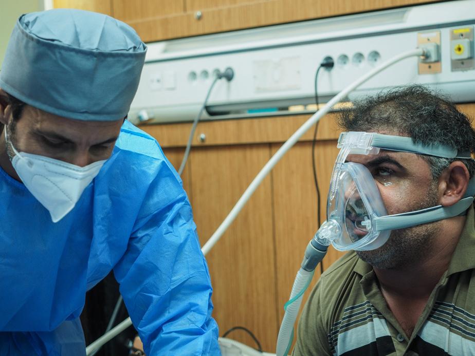 Nurse Mahmoud Mohammed Faraj and patient Mohammed Yusif Radhi