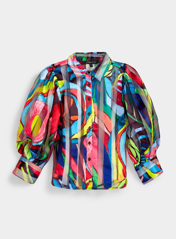 Avec la multiplication des rencontres en visioconférence, on voit poindre un intérêt marqué pour les hauts. On les aime excentriques et colorés, avec des manches bouffantes, qui sont très présentes pour l'automne. Sur la photo: la chemise bouffante rayures multicolores. Prix: 79$
